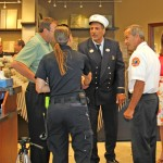 Thomas greets first responder at the Neenah location
