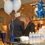 CEO Edward Martin welcomes Thomas in Green Bay