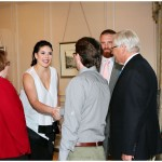 Lindsey (white) and John Kuhn greet arriving guests