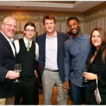 Packers wide receiver James Jones [2nd from R] poses with guests