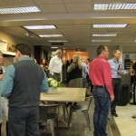 coworkers gather to see the new showroom, H.J. Martin and Son