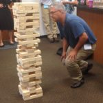 Jeff Giordano plays Jenga at the event, H.J. Martin and Son