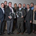 The H.J. Martin and Son team poses with the company's two AGC of Wisconsin awards