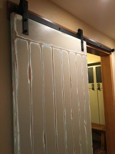 The styled barn door on its hangers!