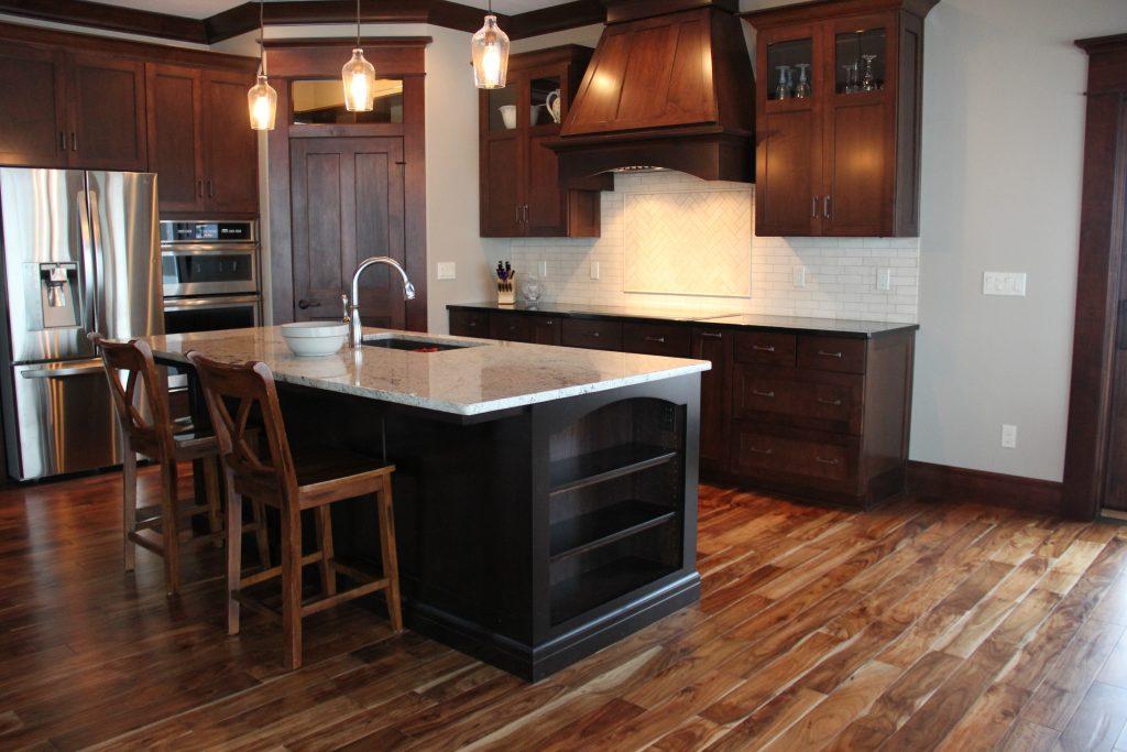 Hardwood kitchen floor with white tile backsplash, H.J. Martin and Son