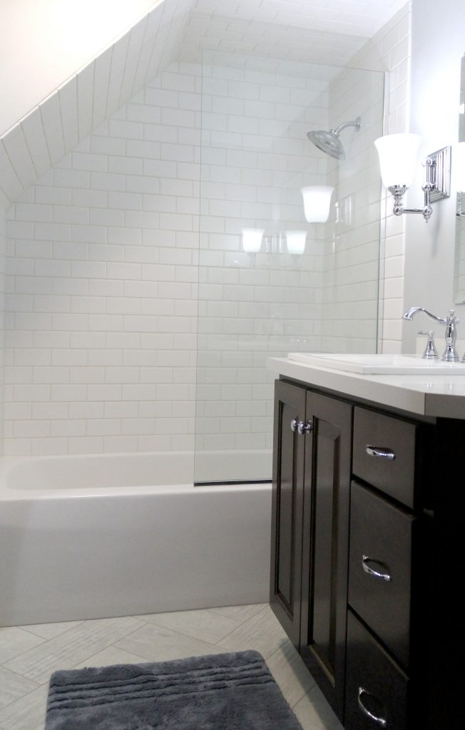 White subway tile shower with bathtub, H.J. Martin and Son