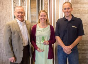 Fred Williamson (left) of Starnet Worldwide Commercial Flooring Partnership congratulates Rachel Weber (center) and Gary VandenLangenberg (right) of the H.J. Martin and Son commercial flooring team on the company's 2017 Gold Starnet Environmental Achievement Award on Sept. 26, 2017.