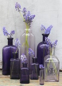 Ultra violet purple vases and lilac flowers