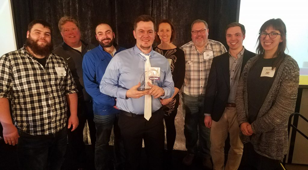 Members of the H.J. Martin and Son team celebrated with Tompkins on March 15 in Milwaukee. On hand were (L-R) Garret Nero, Mike Watermolen, Brandon Pecho, Wyatt Tompkins, Nicole Jensky, Craig Nero, Brandon Schmitz and Alyssa Bloechl.