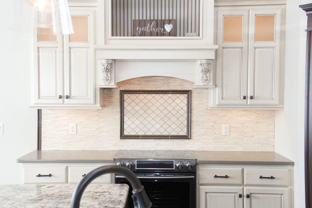 Ivory tile kitchen backsplash, accent stove tile, 2018 showcase of homes, H.J. Martin and Son