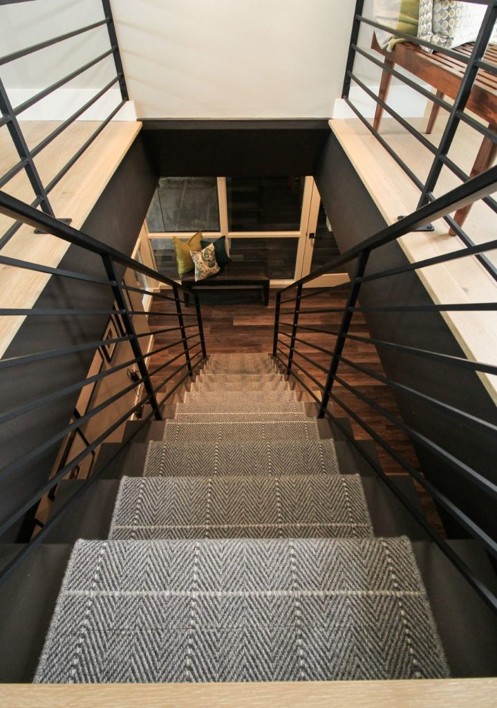 patterned staircase with plaid carpet runner