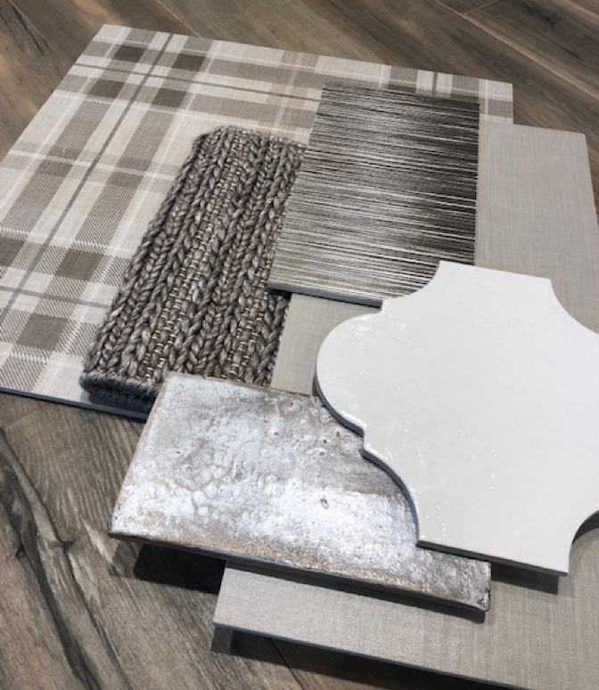 Gray and white tile and gray crochet carpet samples in a mood board.