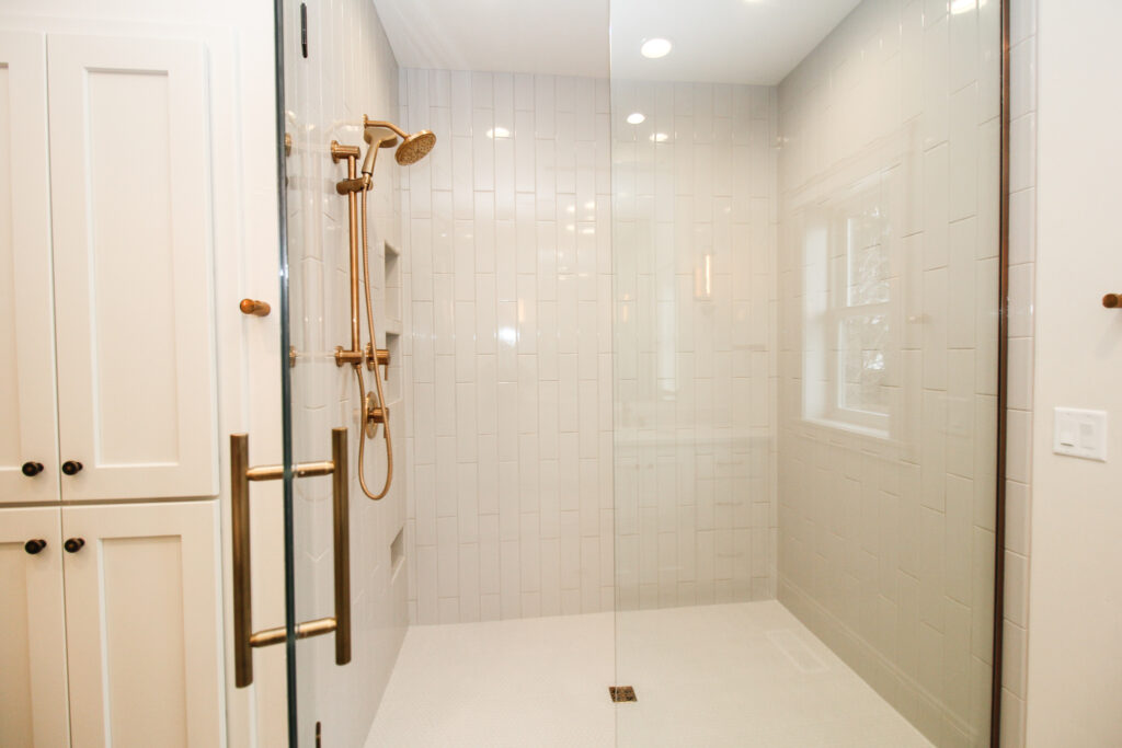 Master Bath Shower with Tiled Flooring and Glass Shower Door