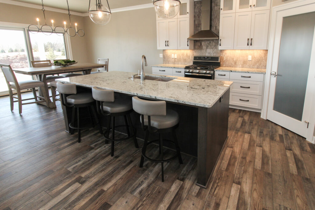 Kitchen with Tan Luxury Tile Flooring and Tiled Backsplash