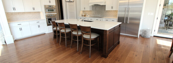 Kitchen with Hardwood Flooring and Tile Backsplash