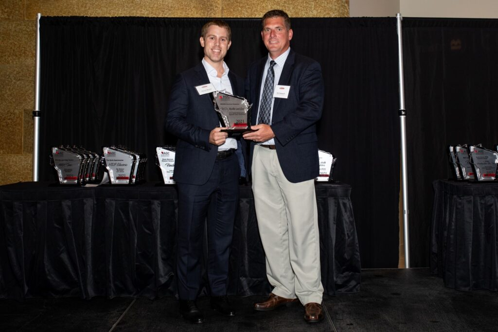 Two people hold AGC Build Wisconsin Award